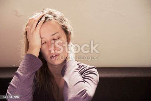 istock Lonely sad woman deep in thoughts 641732550