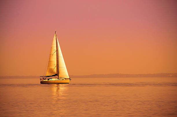 Lonely sail boat stock photo