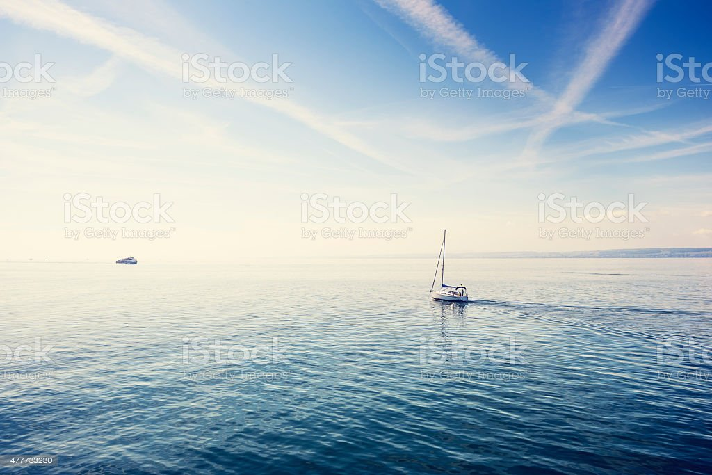 Lonely sailboat on the Constance Lake (Bodensee). stock photo