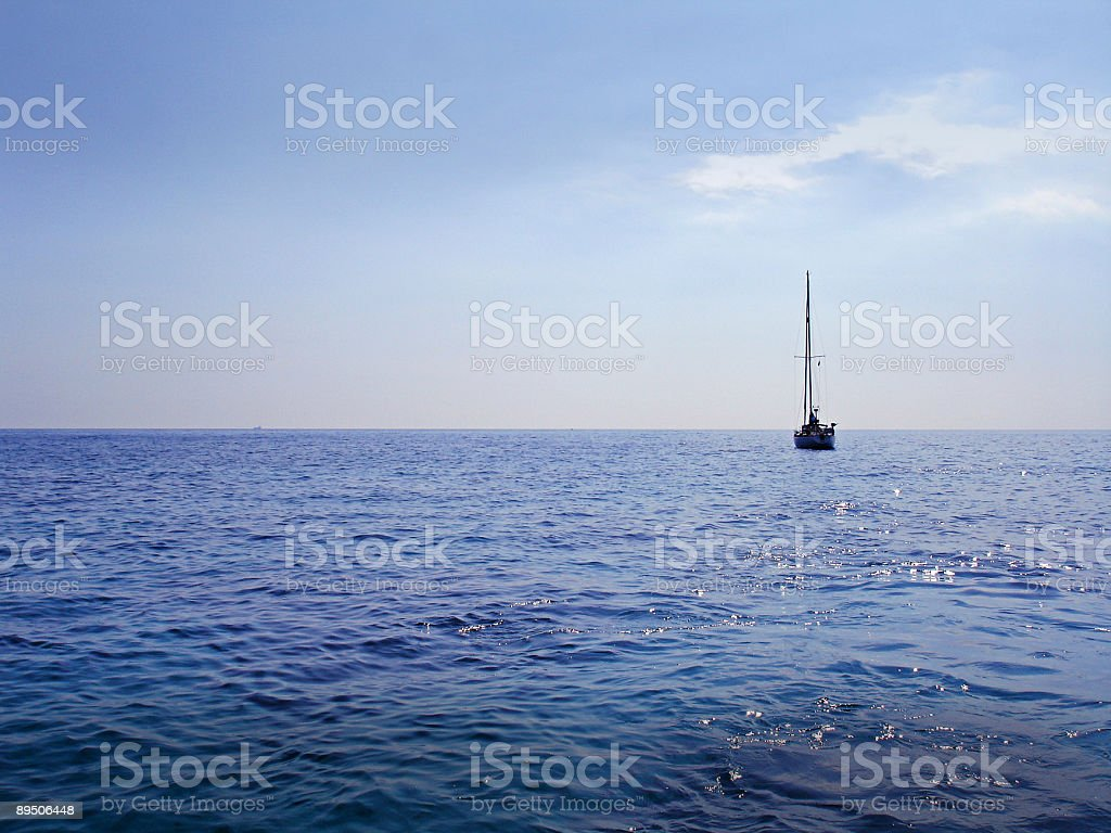 Lonely sailing boat royalty-free stock photo