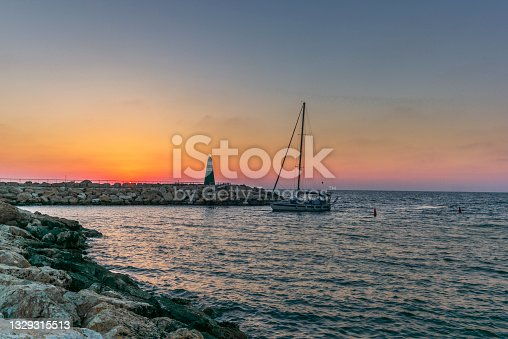 istock A lonely sailingboat returning to the harbour in Tel Aviv at sunset 1329315513