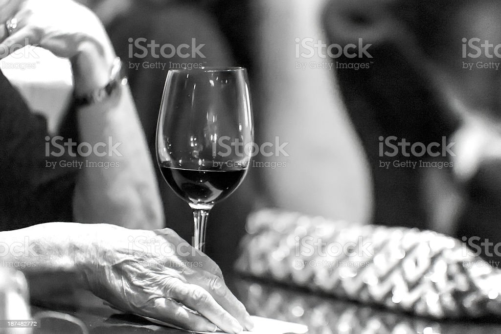 Lonely senior at a Bar with wine glass royalty-free stock photo