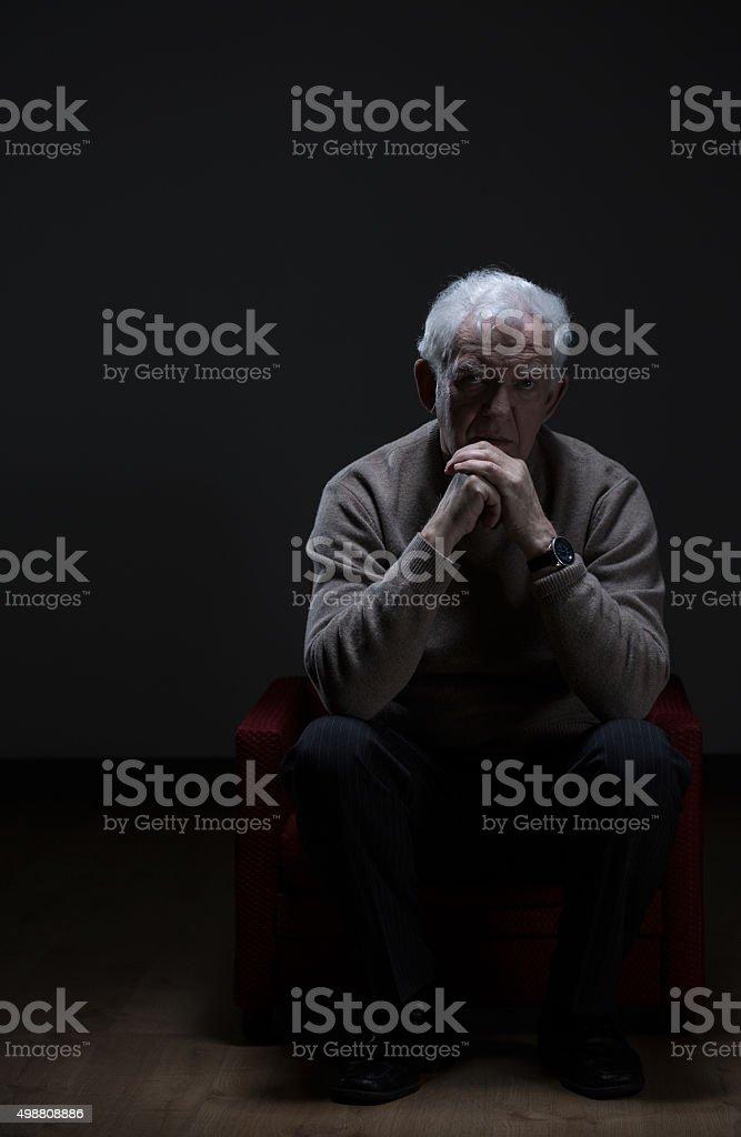 Lonely senior man stock photo