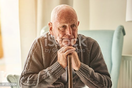 istock Lonely senior man sitting at home 912073304