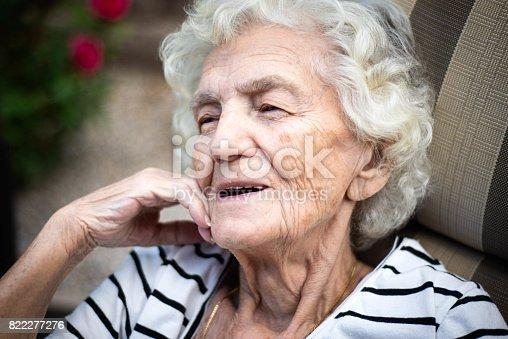874789168istockphoto Lonely Senior Women with Gentle Smile 822277276