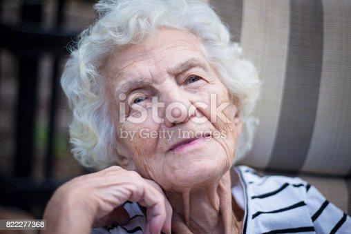 874789168istockphoto Lonely Senior Women with Gentle Smile 822277368