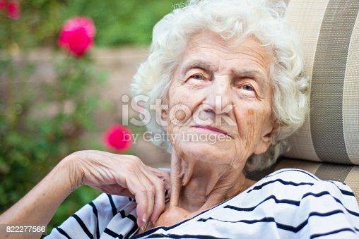 874789168istockphoto Lonely Senior Women with Gentle Smile 822277566