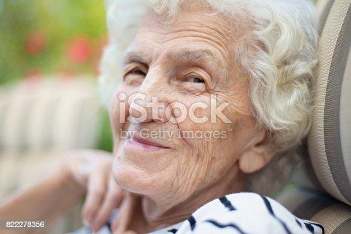 874789168istockphoto Lonely Senior Women with Gentle Smile 822278356