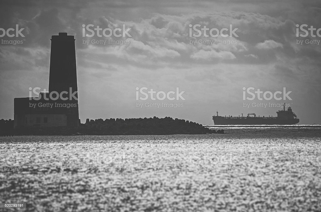 Lonely ship approaching harbor Lonely ship approaching harbor Atlantic Ocean Stock Photo