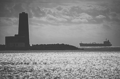 Lonely Ship Approaching Harbor Stock Photo - Download Image Now