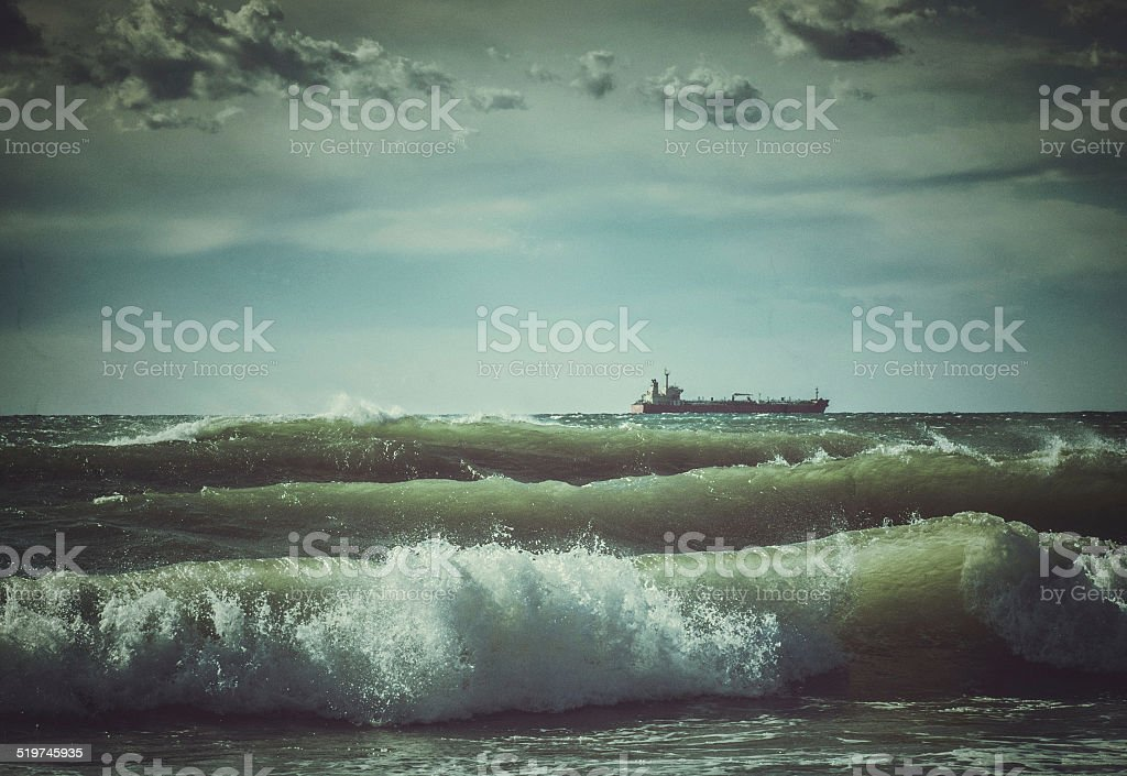 Lonely ship in stormy rough sea Stormy rough sea Atlantic Ocean Stock Photo