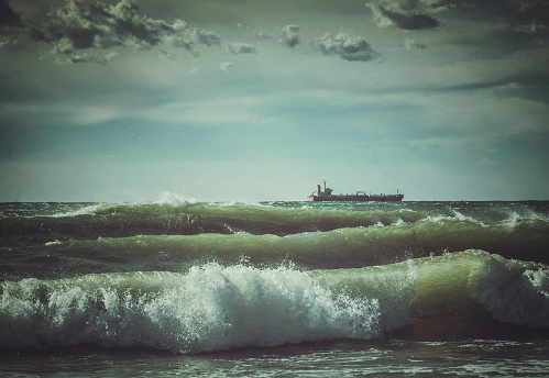 Lonely Ship In Stormy Rough Sea Stock Photo - Download Image Now
