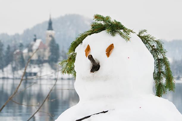 Einsam Schneemann auf Bleder See, Slowenien – Foto