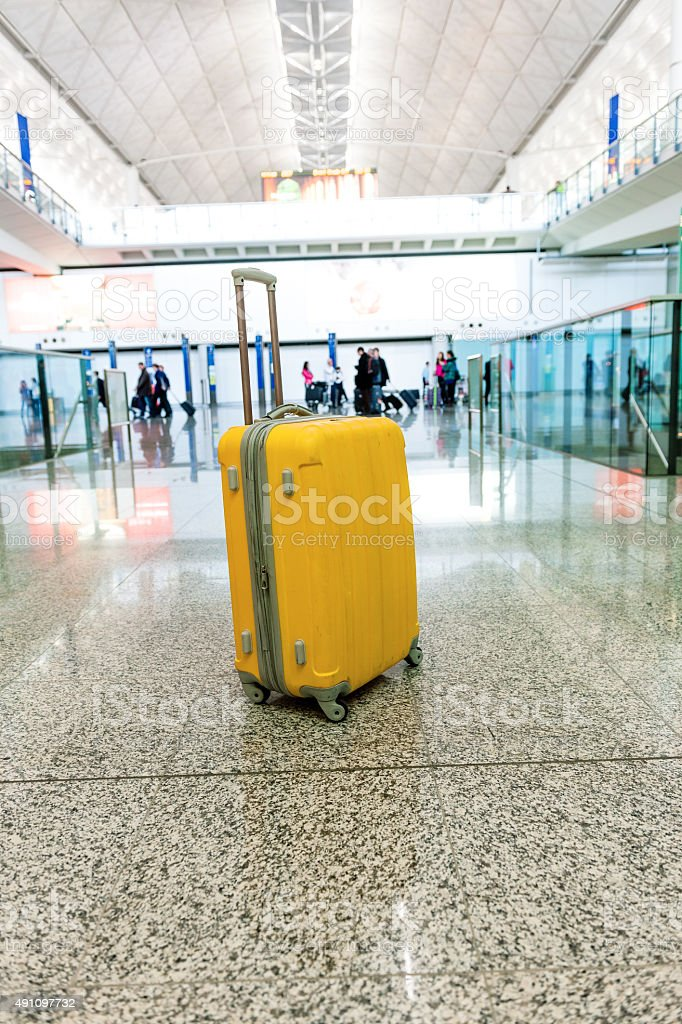 Lonely Suitcase And Red Train In Hong Kong Airport China