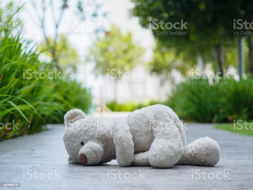 Lonely Teddy Bear Sitting In The Dark Room Concept About Love Royalty Free
