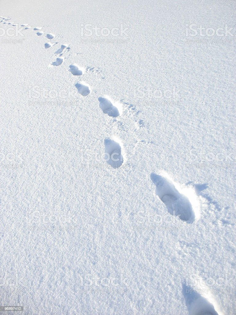 Lonely trace of  person on white snow floor. royalty-free stock photo
