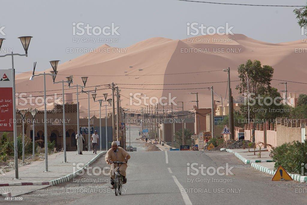 Lonely village of Merzouga with Erg Chebbi Dunes. stock photo