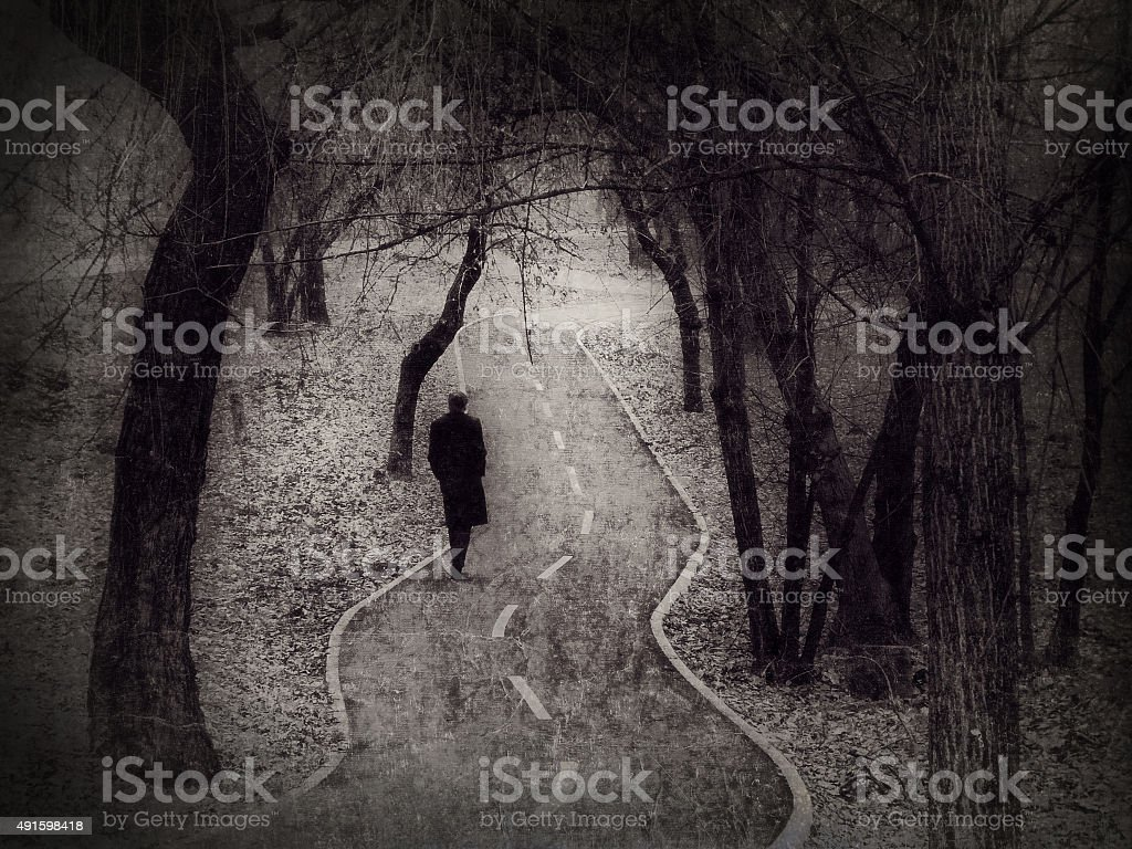 Lonely walk, rite of passage concept stock photo