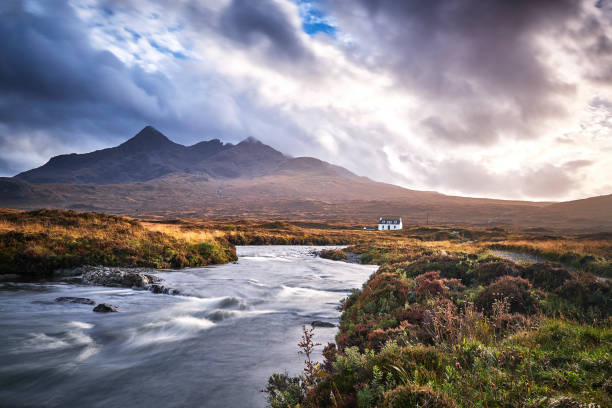 Lonely white cabin in a valley near Sligachan Bridge on Isle of Skye, scotland stock photo