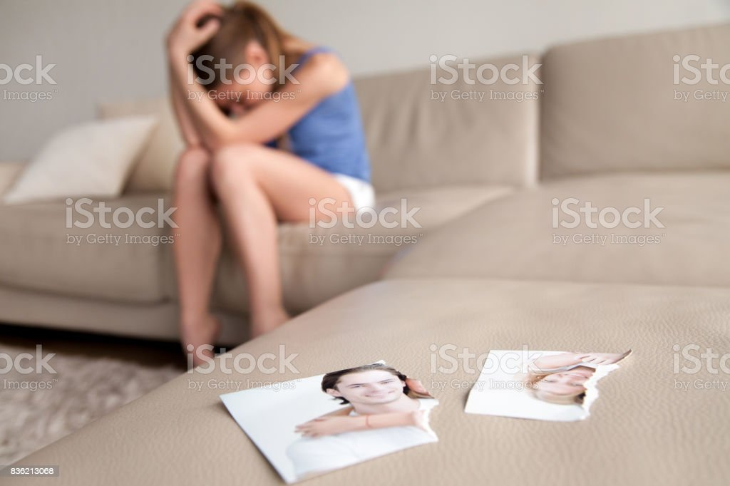 Lonely wife suffering after breakup at home stock photo