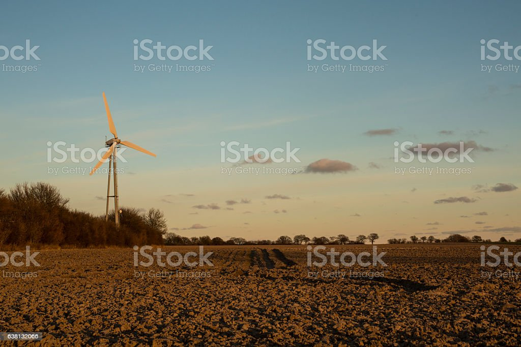 Lonely windmill on a danish field stock photo