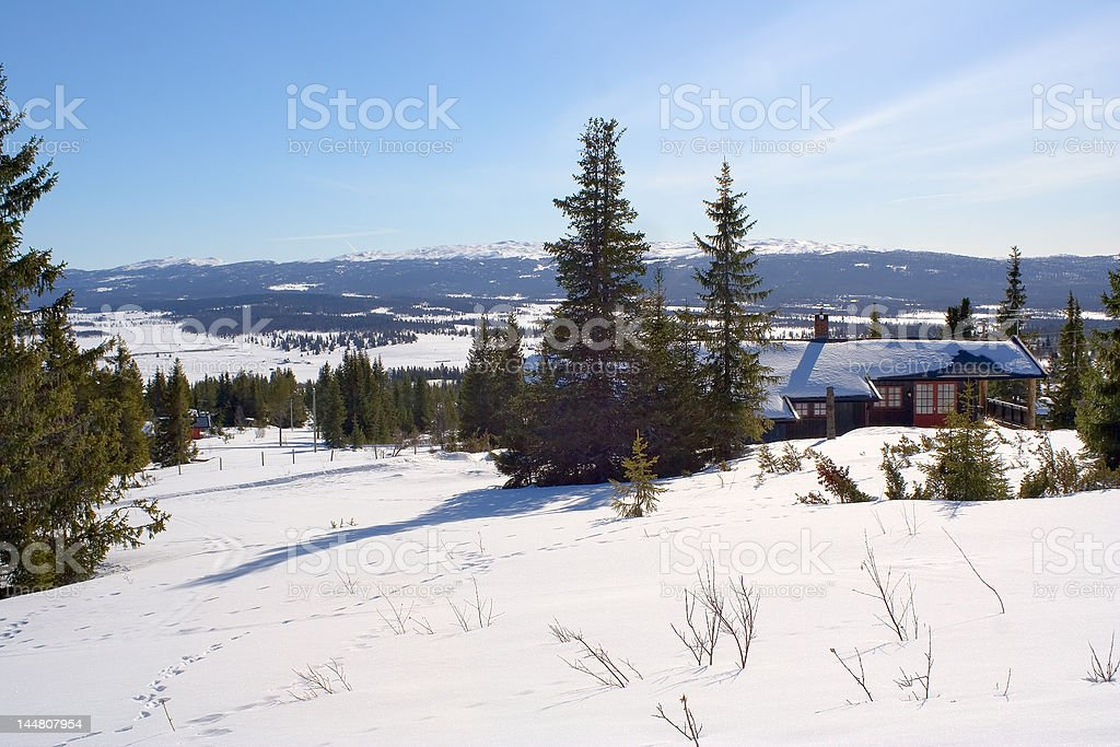 Lonely winter cabin in norwegian mountains royalty-free stock photo