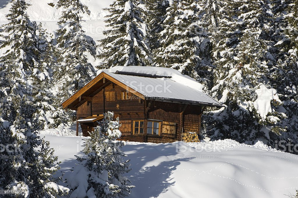 Lonely winter cottage in the forest. royalty-free stock photo