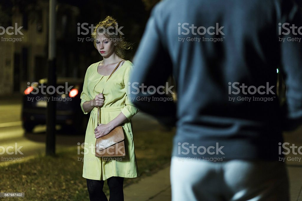 Lonely woman and robber stock photo