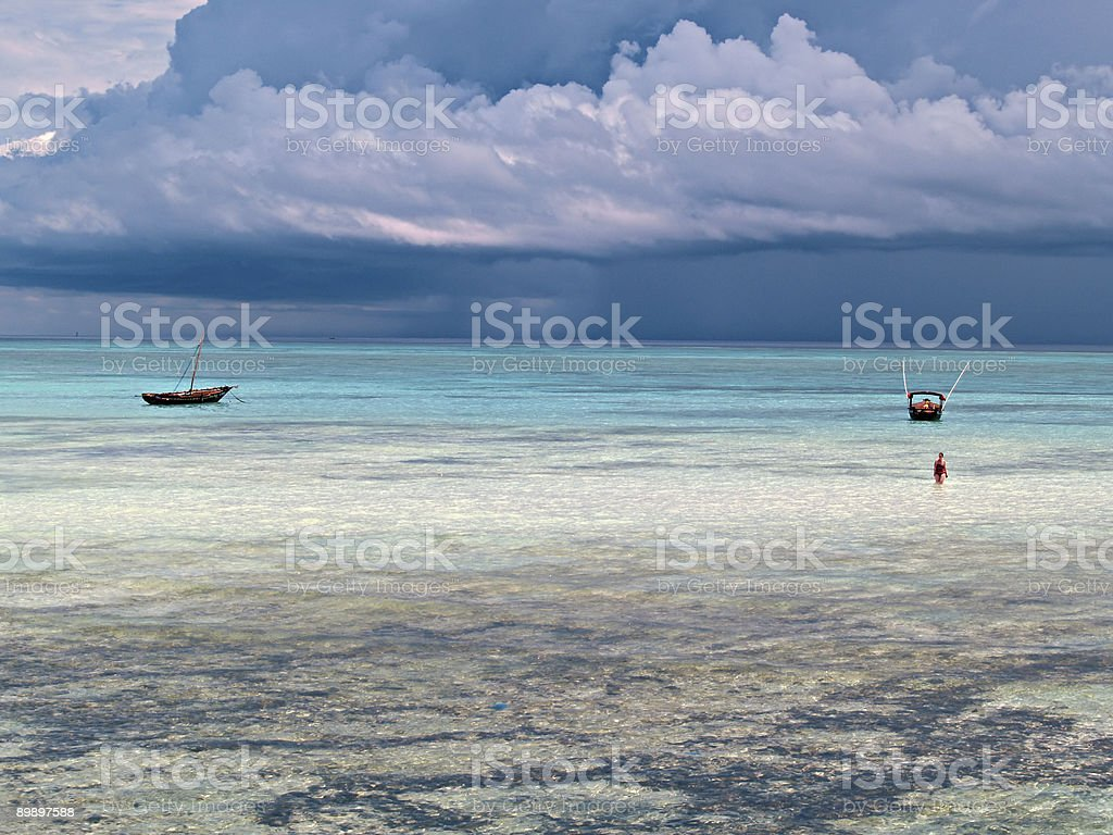 Lonely woman and sailboats near oceanfront royalty-free stock photo