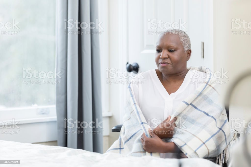 Lonely woman in a nursing home stock photo