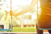 istock Lonely woman missing her boyfriend while swinging in the park 483739730