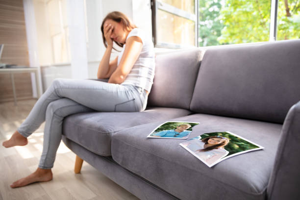 Lonely Woman Sitting On Sofa Lonely Woman Sitting On Sofa With Torn Photograph former stock pictures, royalty-free photos & images