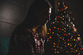 istock Lonely women sitting at home during christmas 868903884