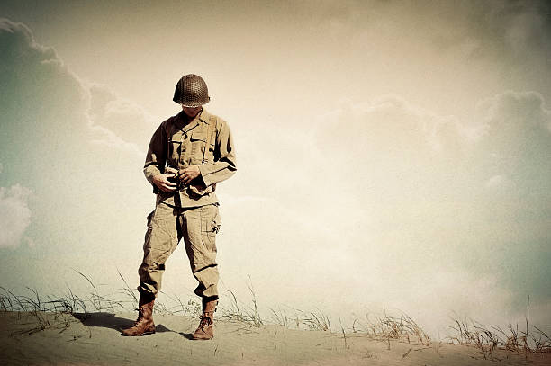 lonely wwii soldier portrait - dreaming of home - world war ii stock photos and pictures