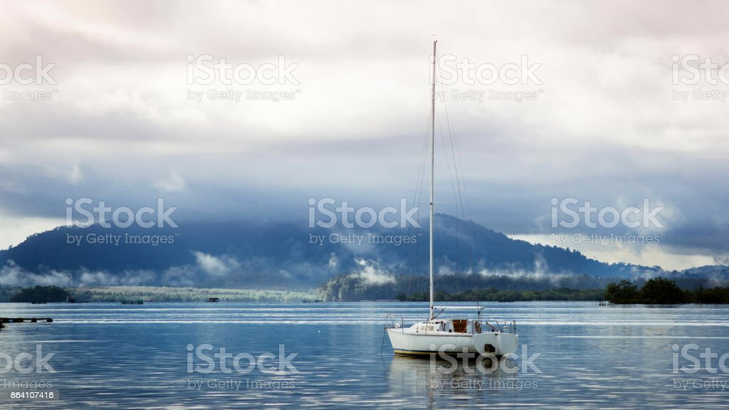 Lonely yacht at dawn royalty-free stock photo