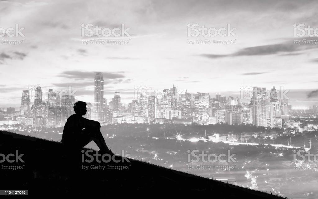 Man overlooking the city.