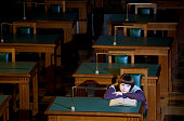 Lonely young woman dreaming in library