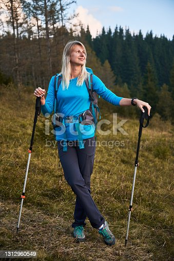 istock Lonely young woman hiking in fresh mountain air. 1312960549