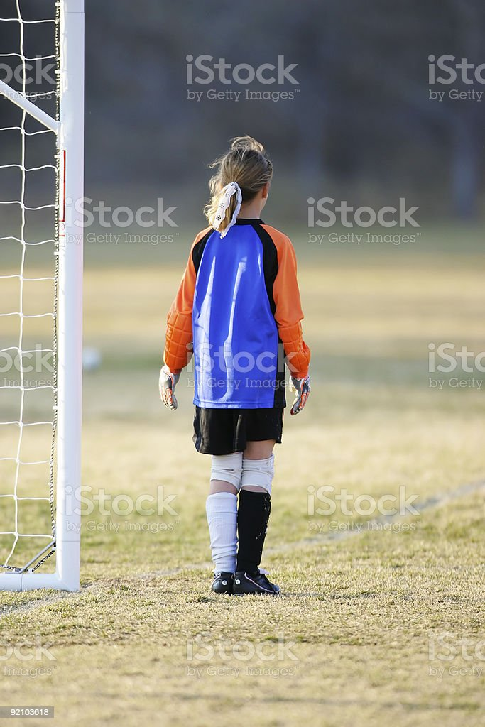 Lonely youth goalie royalty-free stock photo