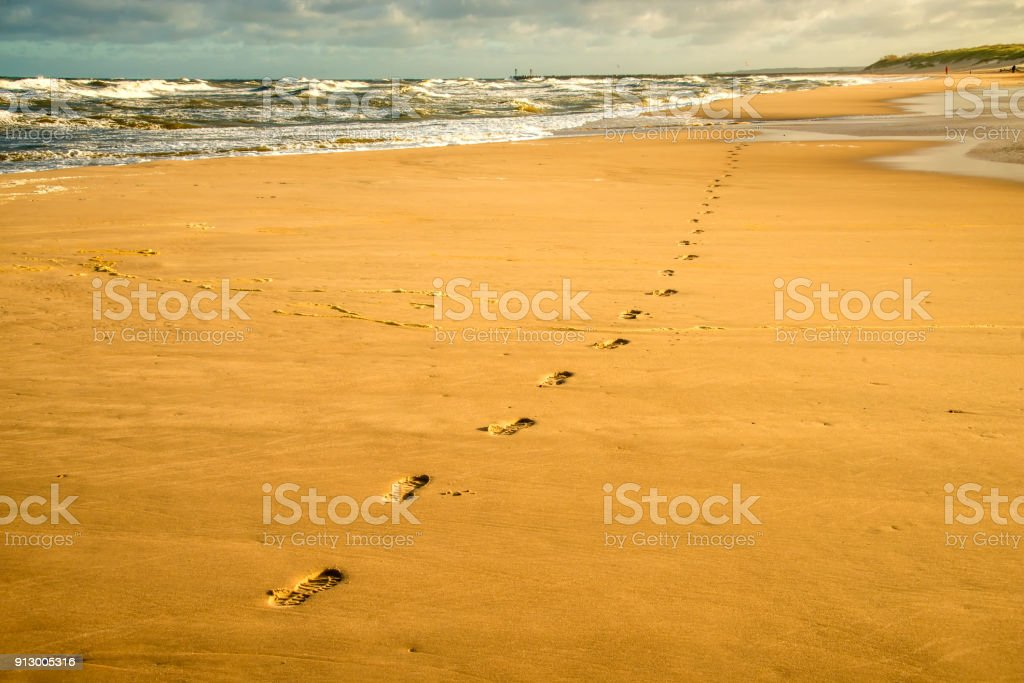 lonesome beach of the Baltic Sea with human track stock photo