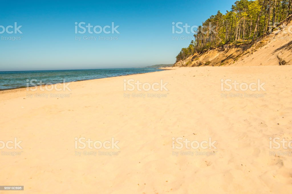 lonesome beach with a blue sky stock photo