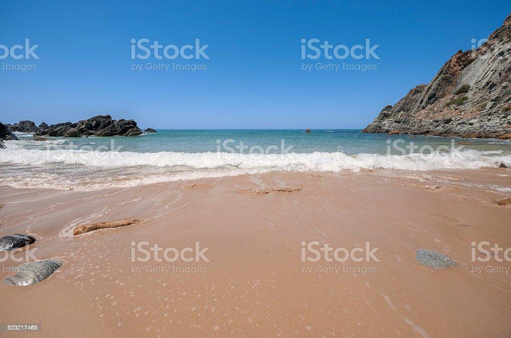 Lonesome sandy beach on the Portuguese coastline near Cascais stock photo