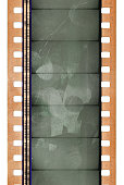 long 35mm film strip isolated with scratches and fingerprints.