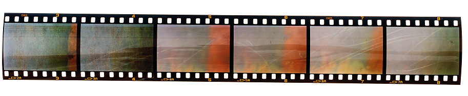 Long 35mm Film Strip With Empty Film Cells Isolated On White Background Stock Photo - Download Image Now