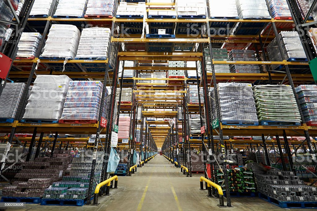 Long aisle between storage racks in a distribution warehouse stock photo