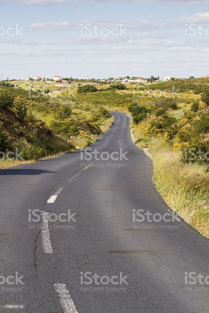 long and curvy asphalt road royalty-free stock photo
