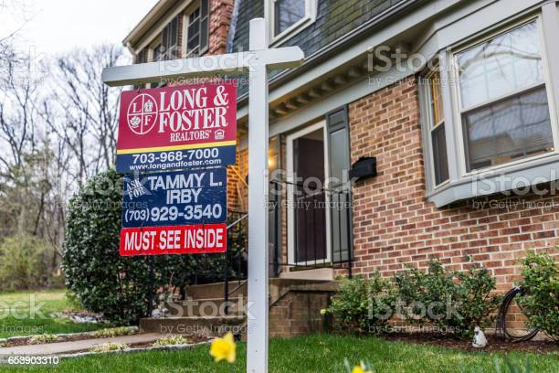 Long and foster real estate sign in front of townhouse with yellow picture id653903310?b=1&k=6&m=653903310&s=612x612&h=g5n9zlwqwd01f1bs8xwysijqfqbqh4gcqyvpfwi g9k=
