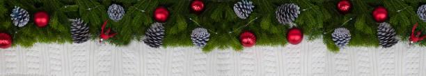 Long banner of fir branches with decorative pine cones and red balls picture id1178474670?b=1&k=6&m=1178474670&s=612x612&w=0&h=kbgu1fs0c90ihdls6vlt6kvsib jrlqebpcvchtesj0=
