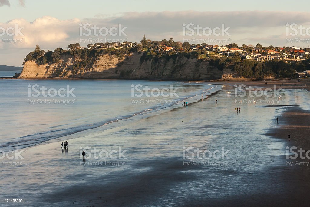 Long Bay beach in New Zealand at sunset stock photo