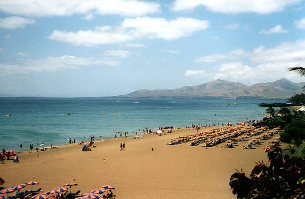 Long beach at Puerto Del Carmen, Lanzarote stock photo